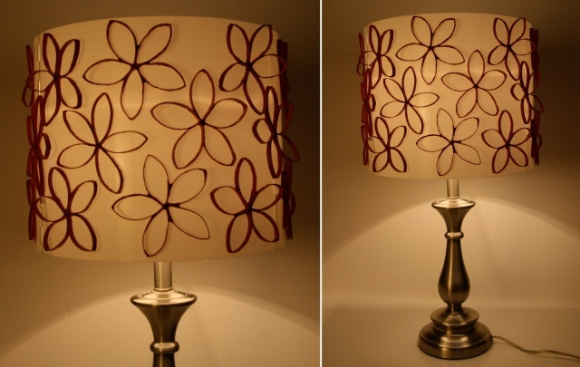 a lamp shade decorated with toilet paper tube flowers, painted pink of course!