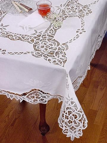 Battenburg Lace Tablecloth. I would love lace tablecloths for the reception.