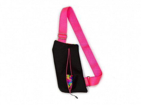 ColorPaks Griffey Crossbody Travel Bag in Pink Psychedlic. Wear this crossbody bag for travel or just everyday errands to keep your essentials secure without weighing you down (or adding bulk). This bag is Made in the USA with durable canvas and carries your must-haves right where you want it to—in a variety of places, like across your chest, on your back, or around your waist. And it's slim enough to fit under a jacket, too.