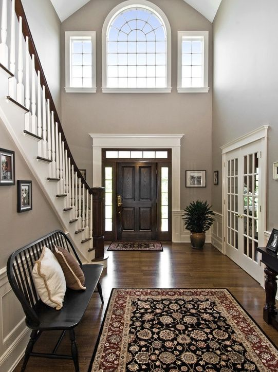 Traditional Entryway with High ceiling, Hardwood floors, Transom window,  specialty door