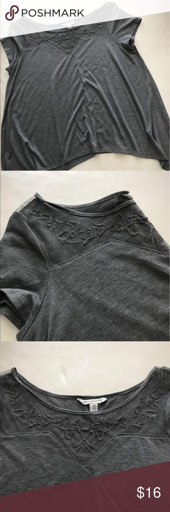🔴SALE🔴AE Outfitters Gray asymmetrical top🖤 American Eagle Outfitters gray cap sleeve asymmetrical top with lace panel.  Flirty little cap sleeve top with sweet lace details. Long on the sides adds to its character Only worn once! In perfect condition ✨ American Eagle Outfitters Tops