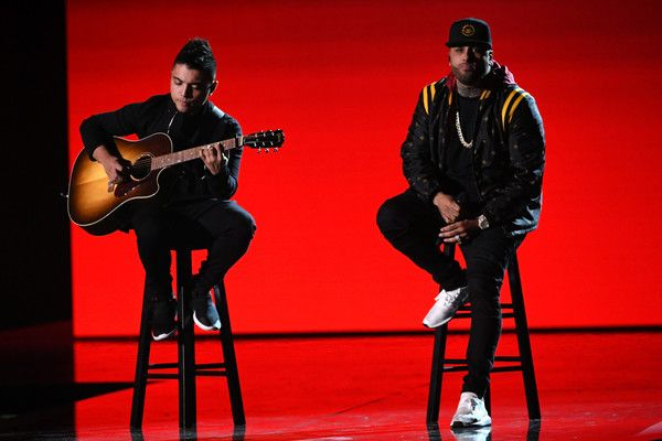 Nicky Jam Photos - Nicky Jam (R) performs onstage at the 18th Annual Latin Grammy Awards at MGM Grand Garden Arena on November 16, 2017 in Las Vegas, Nevada. - The 18th Annual Latin Grammy Awards - Show