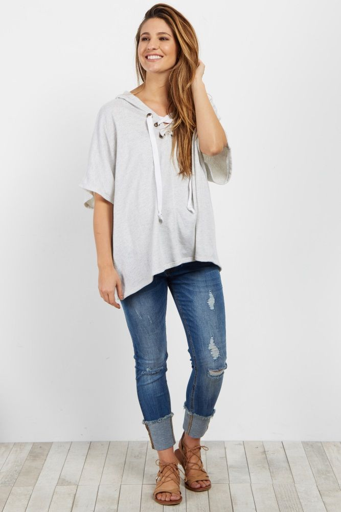 With its cute lace up neckline and comfy material, this maternity top is perfect for any casual day this season. This top features a comfy hood and a great material. Style this top with your favorite denim shorts and strappy sandals for a chic look.