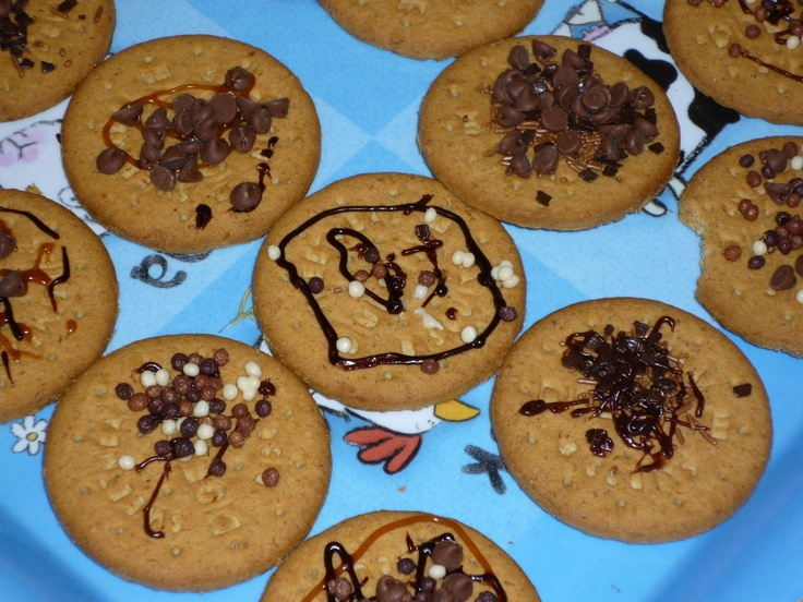 Decorating biscuits always works well for restoring peace ... other simple baking ideas (with and without cooking) at http://gettingstuckin.co.uk/activities/baking/
