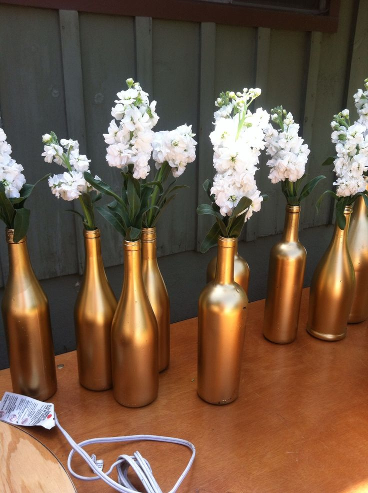 Metallic Gold Spray Painted #WineBottles w/ white flowers #Rustic #Weddings
