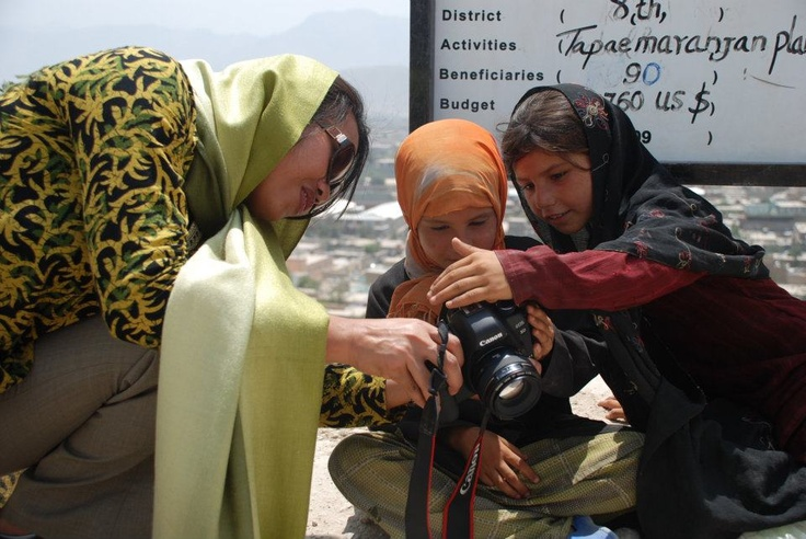 UN Volunteers spend time with children through photography. Photo: Kasman Taslim  — at Afghanistan.
