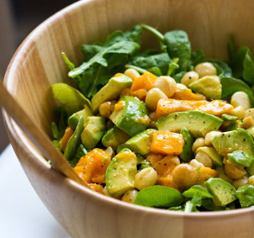 4 ingredient salad recipe: avocado, mango, macadamia nut and arugula! Plus homemade dressing.