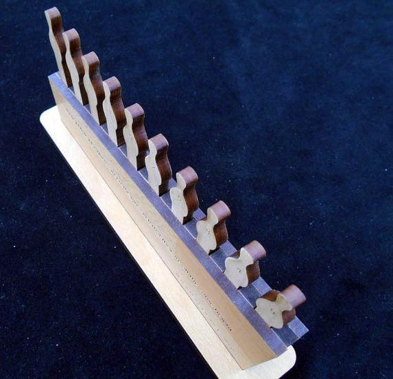 An Escape Room prop with multiple applications. This puzzle can be customized to reveal a numeric or alpha code. The object of this Escape Room challenge is to arrange the pieces so thatthey are all the same height when inserted to the base. The difficulty arises when the team trying to solve it realizeseach piece is a different height and each hole is a different depth.  By default this puzzles comes with each peg (the bowling pin shaped pieces you see in the images) numbered 1 - 10. If…