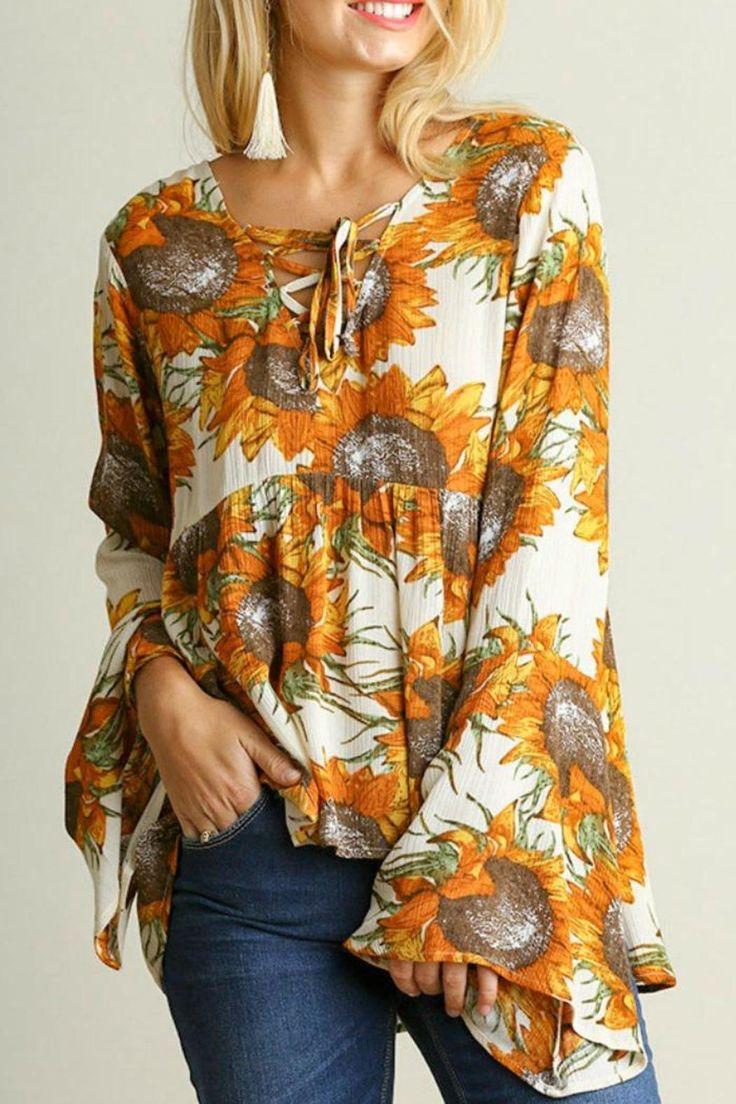 This top features a lace up neckline, bell sleeves, and a beautiful sunflower print! Dry clean only, color will bleed, no bleach, hang to dry   Sunflower Sweetheart Blouse by Umgee USA. Clothing - Tops - Blouses & Shirts Clothing - Tops - Long Sleeve Mississippi