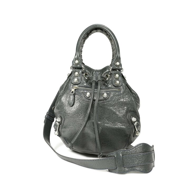 The Balenciaga Motorcycle bag is a classic 'It' bag that has been a favourite of celebrities and stylish women alike. This Mini Pompon features the signature distressed goatskin that Balenciaga uses for its motorcycle bags in Gris Tarmac. Bag features hand stitched handles and a pull closure and is designed with giant hardware in silver toned metal and a leather tassel zipper pull front.   Interior is lined with fabric and features a zip pocket and comes with a leather framed hand mirror…