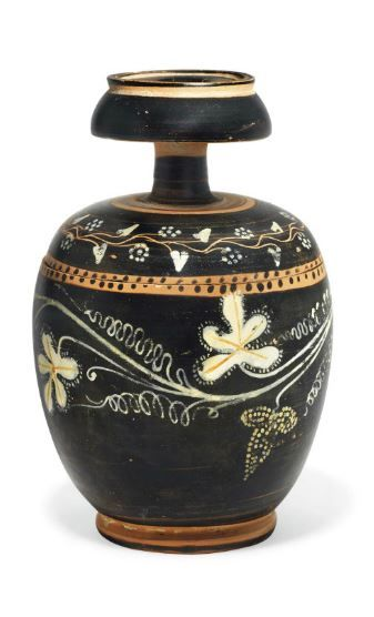 Sicilian gnathia ware pyxis and lid, attribuited to the Vine Group, 300 B.C.   The body decorated in added white and yellow with a vine with two bunches of grapes and four lobed leaves, with spiral tendrils between, a band of dots below the rim, the high knobbed lid with berried ivy wreath, with band of dots below, 16.5 cm high. Private collection