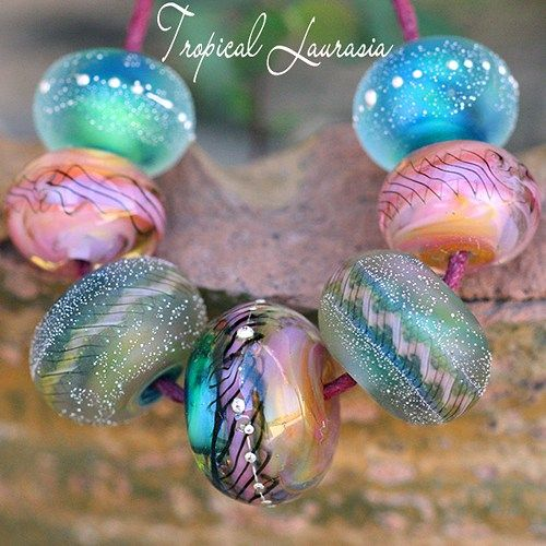 Tropical Laurasia Lampwork Rounds (7)~ Enjoy designing your gorgeous handcrafted jewelry with this graduated set of (7) seven glass round beads, handmade with the finest Italian Glass. Glossy and matt