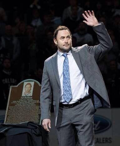 Eddie Belfour..hockey goalie  I have my reasons...just because.