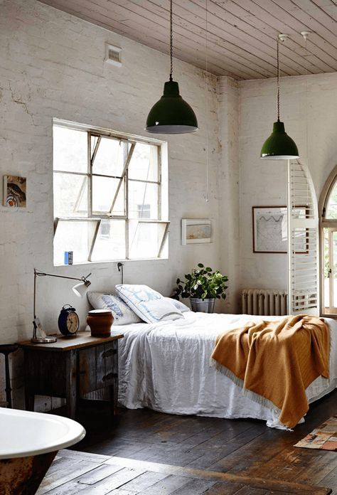 What once was a leather factory is now a super cool home with a kitchen to die for! Everything I love from painted bricks to industrial lighting, some amazing vintage pieces and lets not forget an abundance of stunning art pieces! #bedroom #industrial #interior #decor
