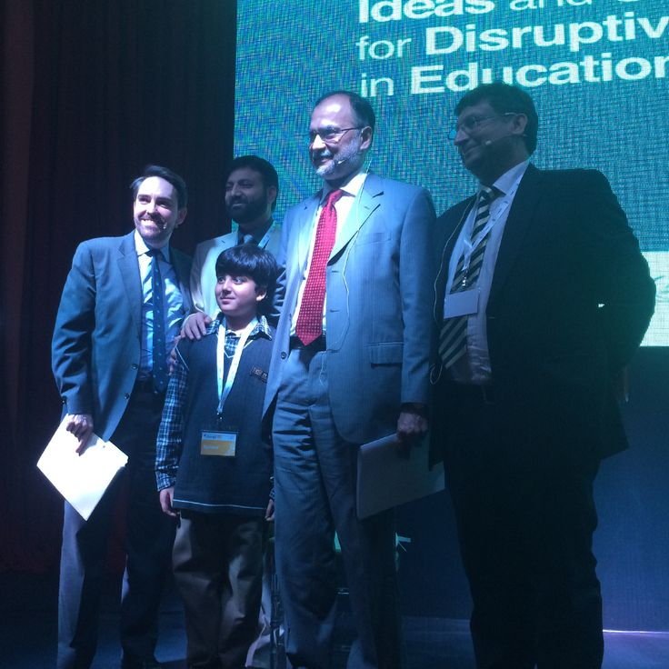 Federal Minister Prof. Ahsan Iqbal, UNDP Pakistan Country Head Marc-Andre Franche and Athar Osama of the Pakistan Innovation Foundation with the 9-year old O-level world record holder, Haris, at #DisruptEd.