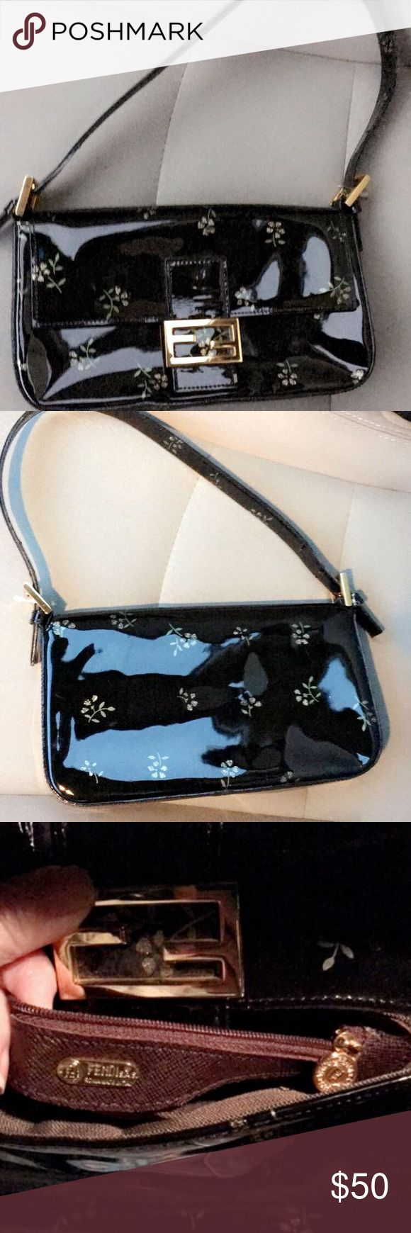 Fendi Black & Gold Patent Pochette Bag Super cute bag that can fit a wallet, cell phone and make up. Has front snap closure and one interior pocket. The exterior design is patent with gold glitter floral/flower design. Excellent condition as I've never used it and is just sitting pretty in my closet.  I couldn't find the serial number so the price reflects AUTH.  Please check out my other items like Vuitton, Tory Burch, Gucci, Jimmy Choo, etc. Bags Mini Bags