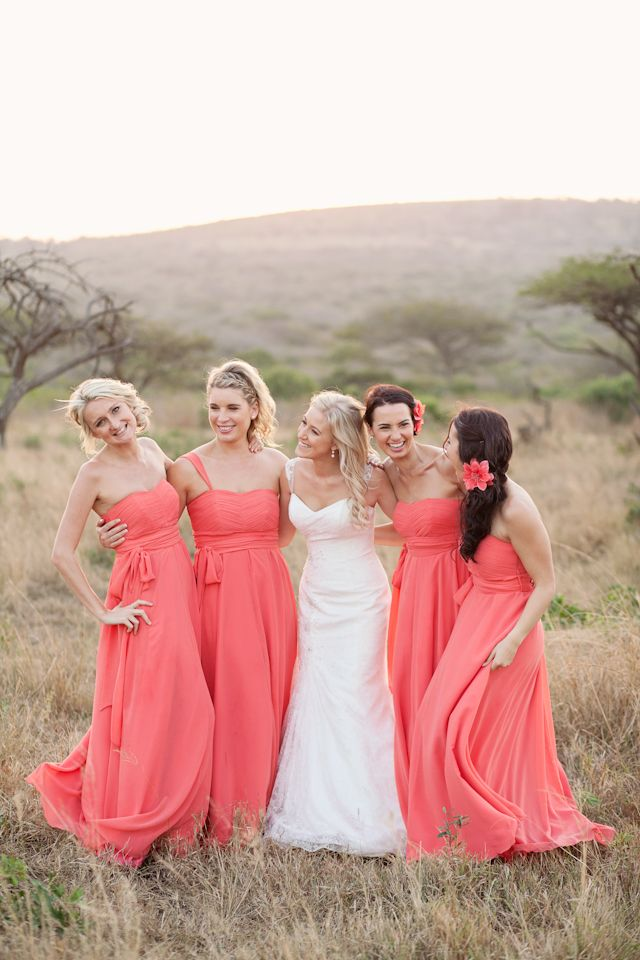 coral bridesmaid dresses. i love how vibrant these dresses are, and the contrast to the white. May want long dresses now!