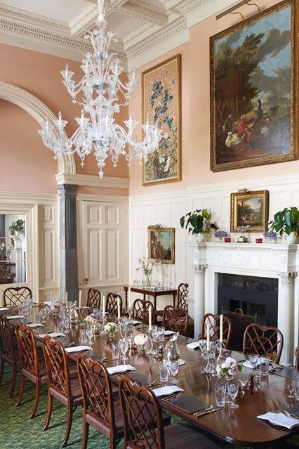 A Venetian Glass Chandelier Hangs Above The Mahogany Table In Dining Room Of This Century House
