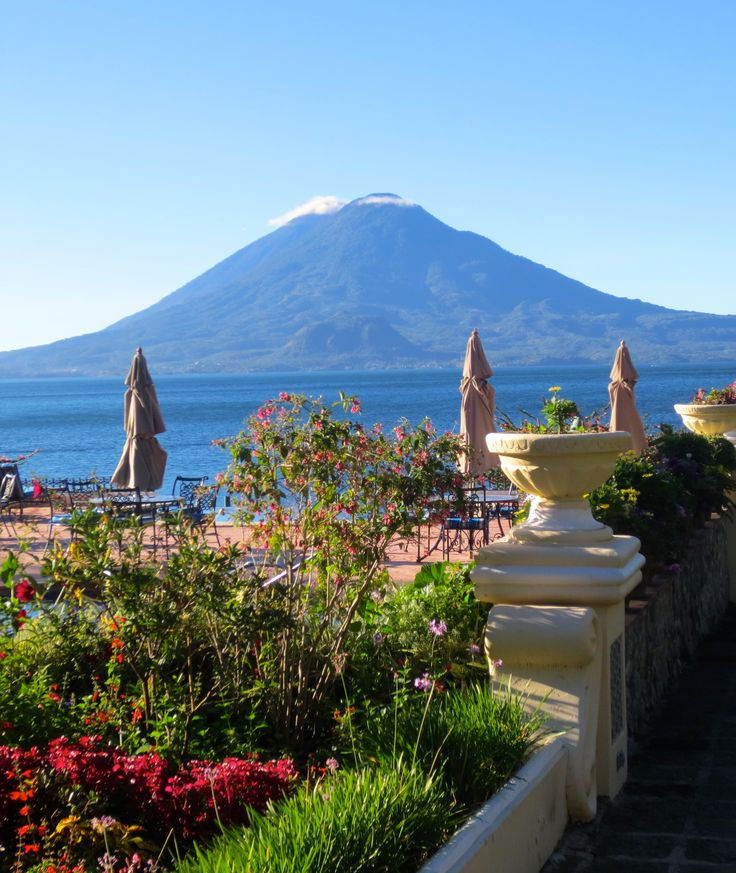 Artisan Connect travels to Guatemala- this is a beautiful hotel we visited on Lake Atitlan, with the towering volcano in the background. What a scenic and relaxing place for lunch! #artisanconnect
