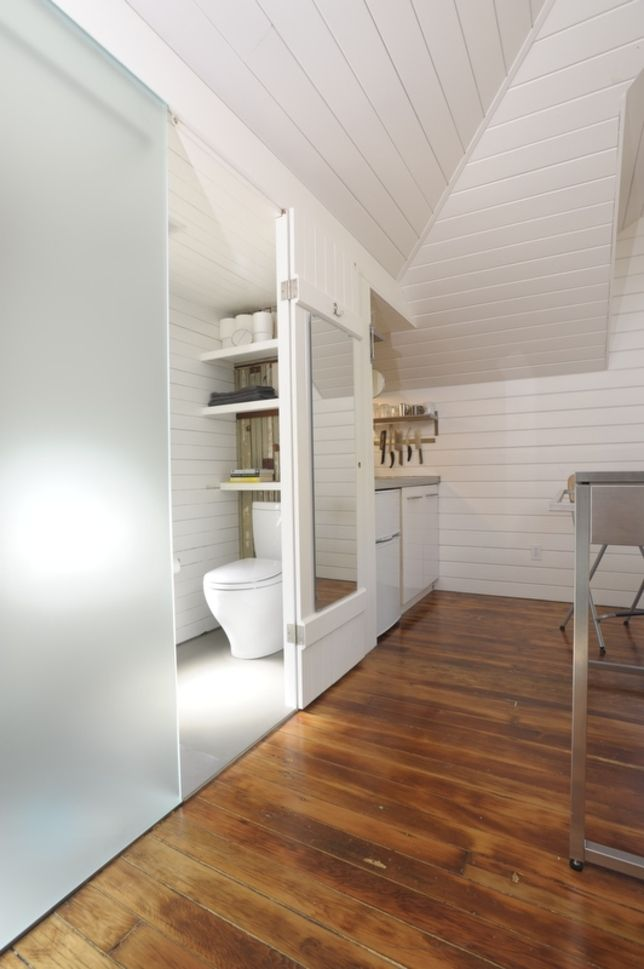 would be good for upstairs bath. dormer, closet-like feel. clapboard walls.