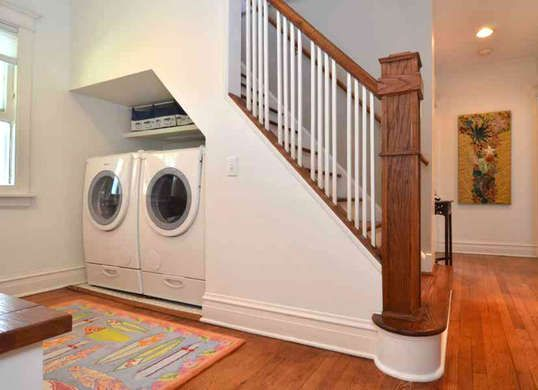 Laundry room in an under stair nook! There's even space for a set of shelves