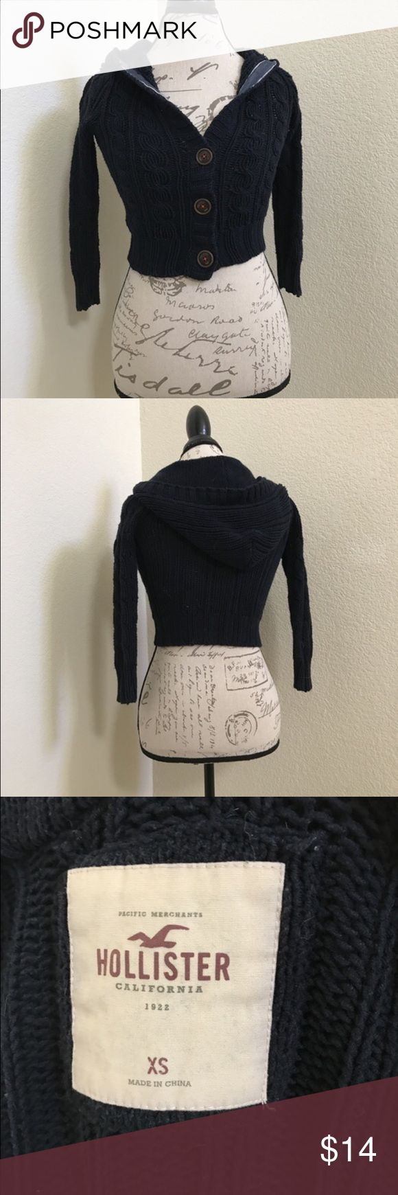 Navy Hollister Crop Knit Cardigan Navy Hollister Crop Knit Sweater w/ Hood. Super cute and in great condition! #hollister #navy #cropknit #crop #knit #crophoodie #hoodie   *I am open to negotiations and I love doing bundle deals! Message me!  *If you need any measurements or have any questions please don't be afraid to ask!  *I try my best to list the true condition of the item as far as any flaws, defects, or holes!  *Everything is from a non-smoking home, pet friendly home!  *Ask me…