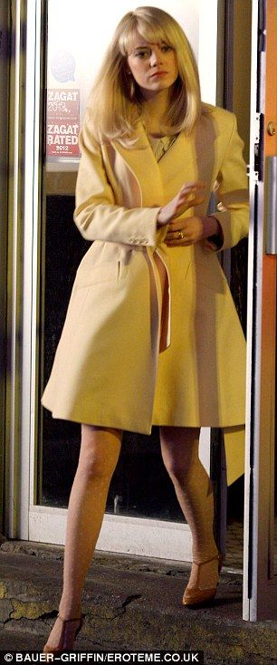 Something on your mind?: In character Emma looked very pensive as she stepped out in her yellow trench coat