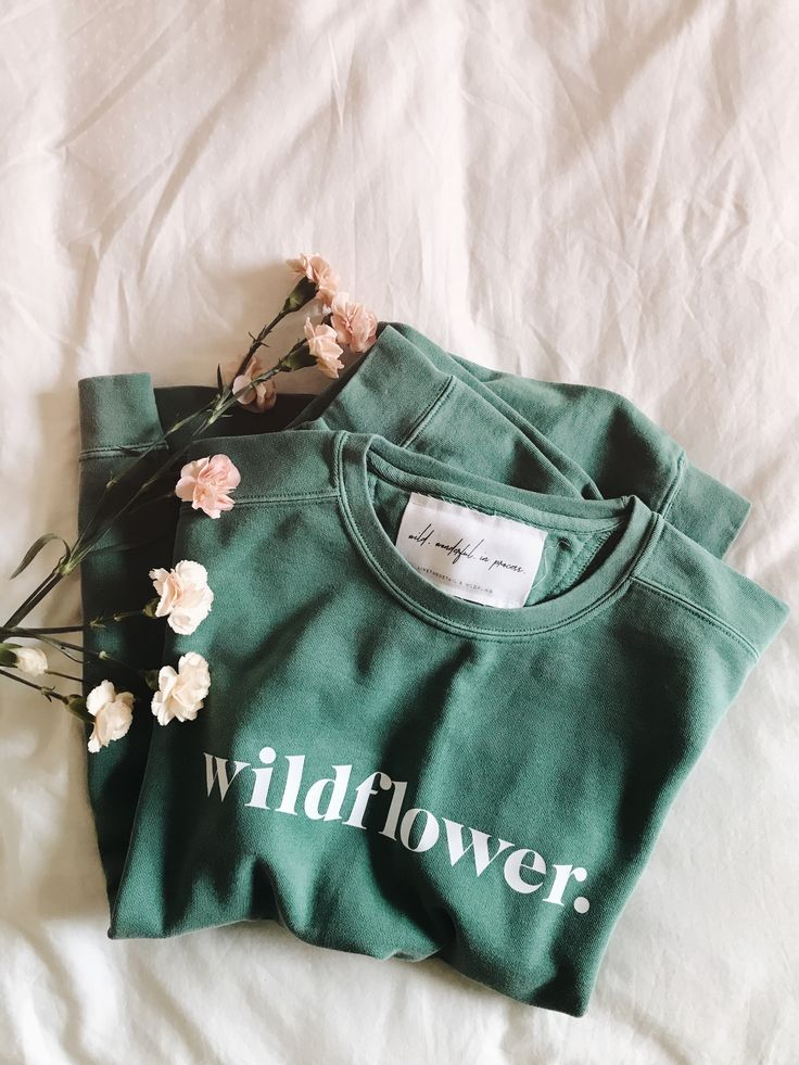 a vintage washed-out sea foam green crewneck sweater to remind you of the wildflower message. you are wild, wonderful and perfectly in process. $29.99
