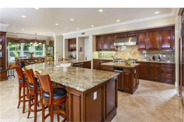 The chefs dream kitchen features Stainless Steel Viking appliances; dual ovens, microwave, dual dishwashers and stove. RESORT LIVING AT HOME | LUXURY HOMES 6381 Twilight Drive, Huntington Beach, CA  #VikinginCA