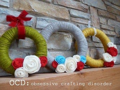 yarn wreaths   LOVE the Christmas colors!