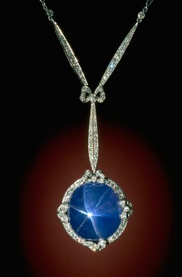 This Art Deco-style platinum necklace designed by Marcus & Co.* features a 60-carat sky blue star sapphire from Sri Lanka in a setting studded with 126 diamonds.