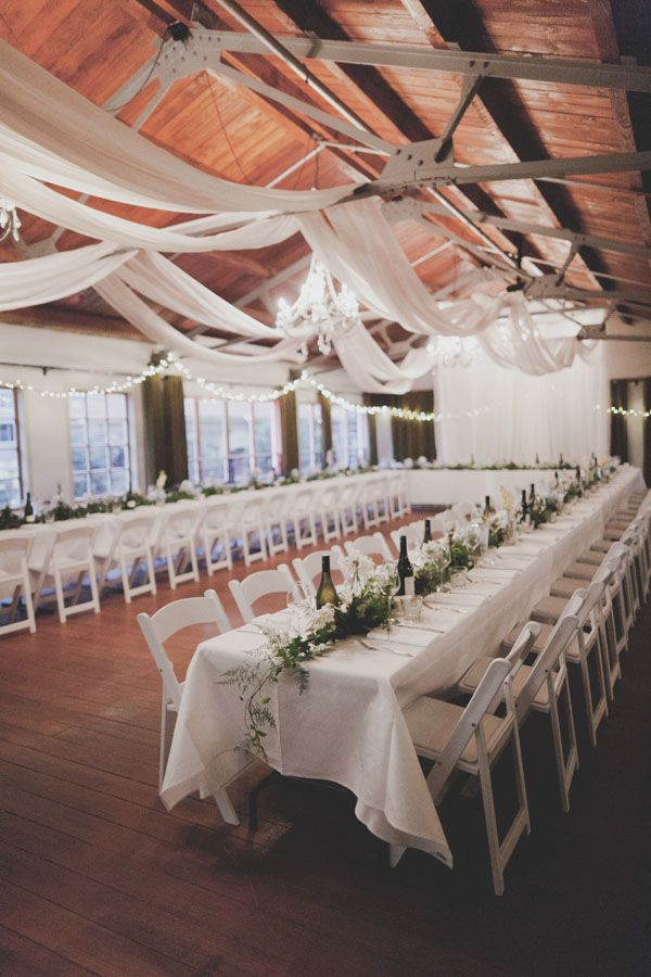 white-garland-centerpiece-tables-reception-decor. Oooo I know of at least two places with rooms like this, both overlooking a river.