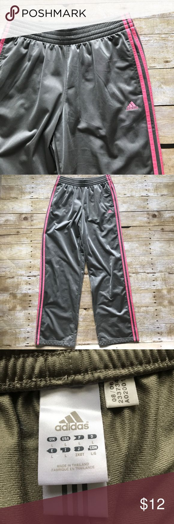 Adidas Sweat Pants Light army green with pink logo and steipes. Stain on the front left leg by the logo. Can be taken out with icy clean I just don't have any! Price reflects the stain. Other than that no rips or holes!! ☀️ Coming from a pet friendly home of one adorable Pomsky named Lulu :) Adidas Pants Track Pants & Joggers