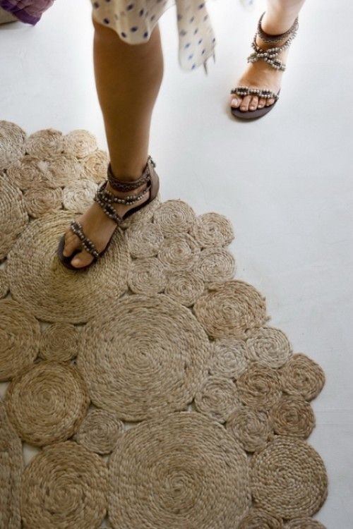 DIY Rustic Rug Of Jute Or Sisal Rope. Hot glue the coils. Sew in key spots for durability. Make the smaller pieces first and then attach them together to get a larger rug. I love the random design - perfect for my front porch.