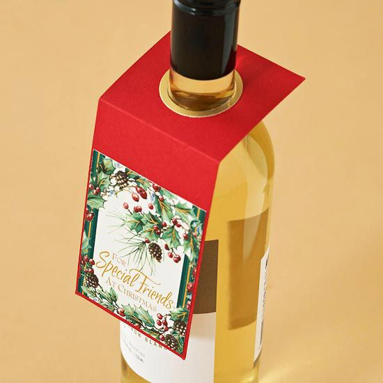 Reuse Christmas Cards Make a wine gift label feel more personal by adding a handmade gift tag made from recycled Christmas cards. Cut a 2-3/4x6-3/4-inch rectangle from red cardstock. Score the card 2-1/2 inches from the top, and use a 1-1/4-inch hole punch to create an opening for the neck of the wine bottle in the center of the upper section. Punch a 1-1/4-inch hole in gold cardstock; punch around the hole with a 1-1/2-inch hole punch, creating a ring.
