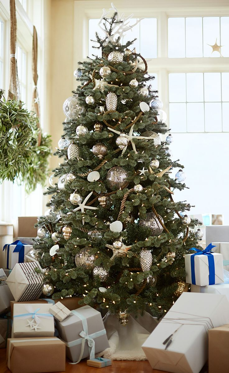 Inspiration - love the rope and scale of ornaments, bling and burlap.   Christmas Styles | Pottery Barn