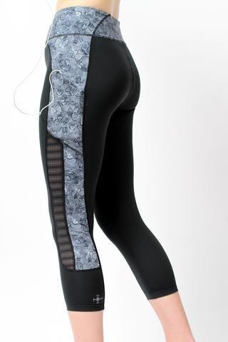 Side of woman wearing She's Got Heart Mesh Capri Leggings by Epidemia Design...