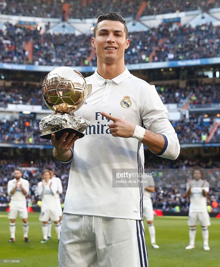Cristiano Ronaldo of Real Madrid CF shows his fourth Golden Ball to the audience prior to start the La Liga match between Real Madrid CF and Granada CF at Estadio Santiago Bernabeu on January 7, 2017 in Madrid, Spain.