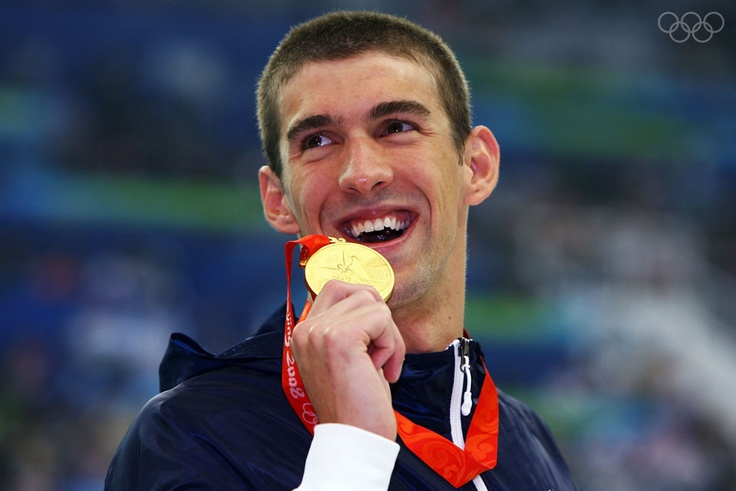 BEIJING - AUGUST 10:  Michael Phelps of the United States poses with the gold medal during the medal ceremony for the Men's 400m Individual Medley event held at the National Aquatics Center during day 2 of the Beijing 2008 Olympic Games on August 10, 2008 in Beijing, China.  Michael Phelps of the United States finshed the race in a time of 4:03:84, a new World Record.  (Photo by Shaun Botterill/Getty Images)