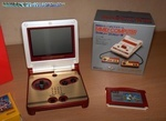 The GameBoy Advance SP Famicom Edition (Club Nintendo Japan edition). Omg.  <<  Sweet.  gotta love the little FC box.  wish the pic was higher rez.