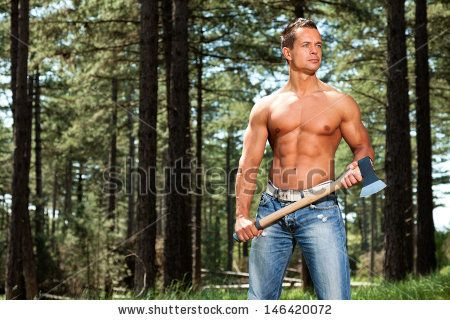Shirtless muscled fitness lumberjack man with axe in forest. by Ysbrand Cosijn, via Shutterstock