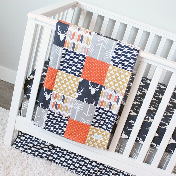 Deer Crib Bedding Three Piece Set includes: Patchwork Blanket Crib sheet Crib Skirt Details: Patchwork Blanket - 34 x 49 backed with grey minky - grey arrow, navy tomahawk, mustard teepee, navy buck, orange/brown chevron slices, orange pindot. Add batting to blanket - https://www.etsy.com/listing/85090201/batting-add-to-blanket?ref=shop_home_active_1 Crib Sheet - navy buck Crib Skirt - 14 drop, center pleat - Top: grey arrow, Bottom: navy tomahawk strip...