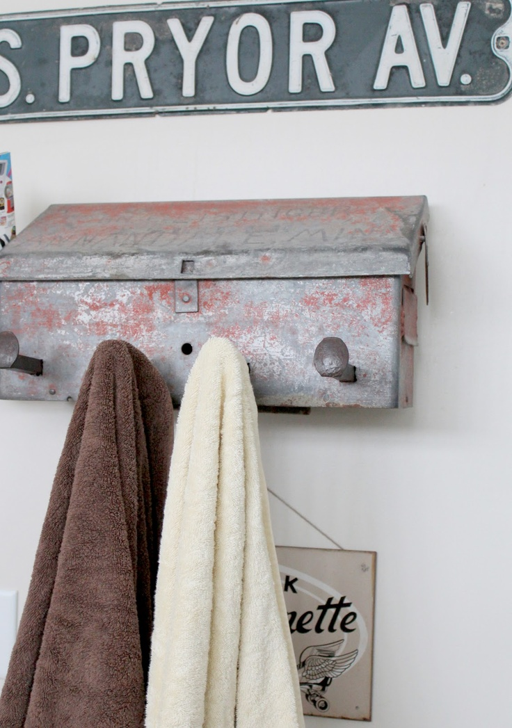This would be sweet for hanging and storing garden tools. Vintage mail box with old railroad spikes.