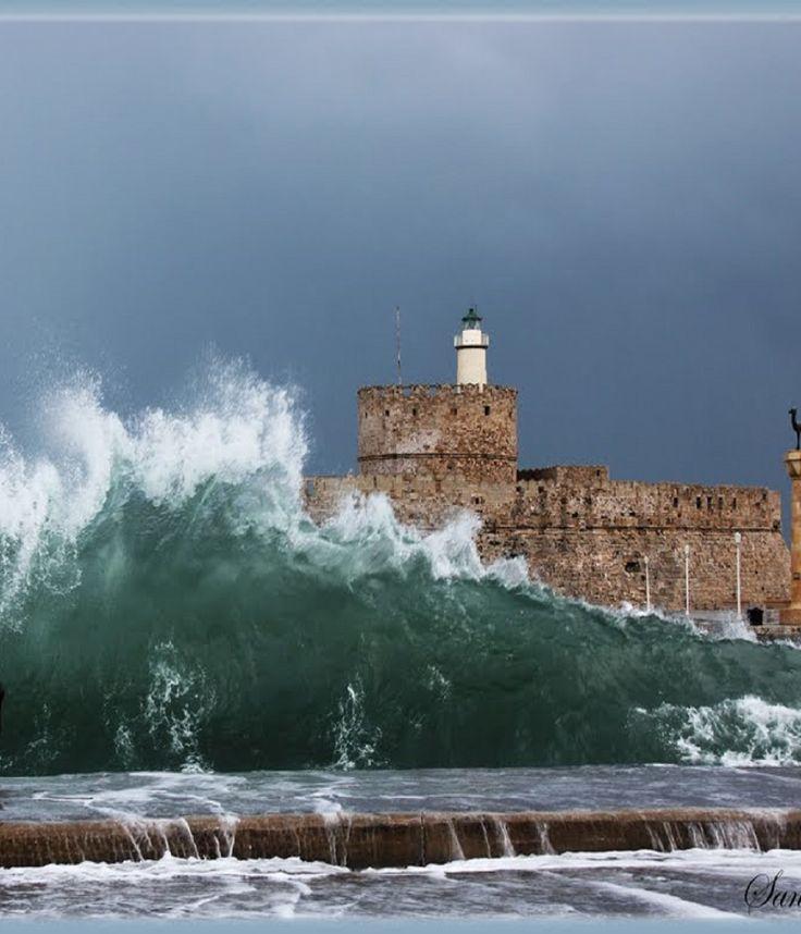 Rhodes Greece lighthouse - tower of St. Nicholas. - Ρόδος ο φάρος - πύργος του Αγίου Νικολάου.