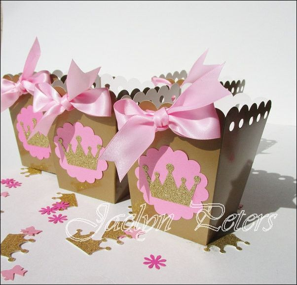 Our hand made pink and gold glitter crown popcorn favor boxes are perfect a girl's princess theme birthday party. Add sparkle to your baby shower dessert bar or fill with your own candy treats and gif