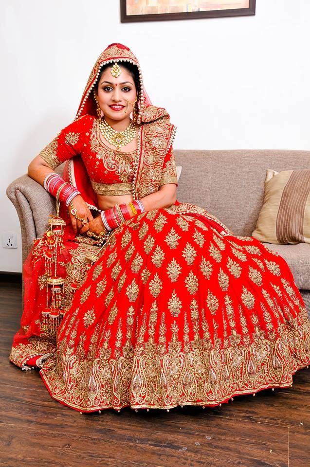 #WeddingSutraP2W  A Red Lehenga choli with heavy gold work and a heavy Gold border for Bride Shama Thakur of WeddingSutra. Photo Courtesy- Shutter Time