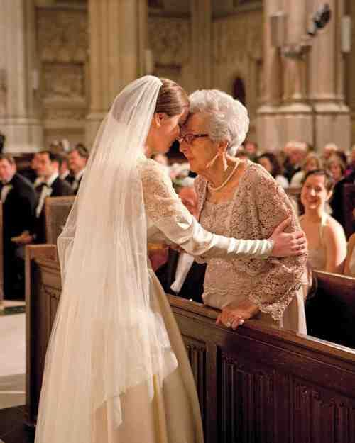 """With a hug and kiss, the bride honors her grandmother and """"best friend"""" as """"Ave Maria"""" plays in the background."""