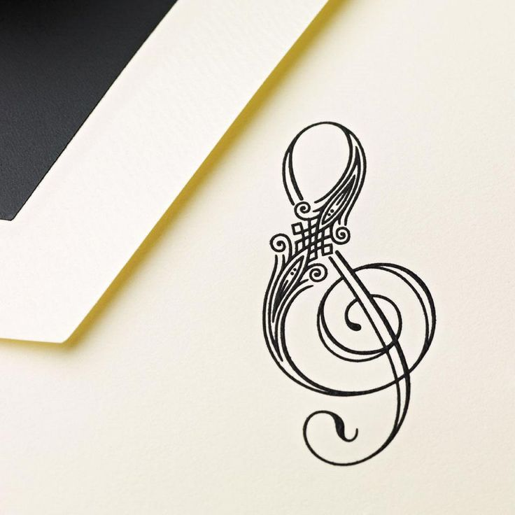Great inspiration for a musical tattoo! | Hand Engraved Treble Clef Note by Crane & Co.
