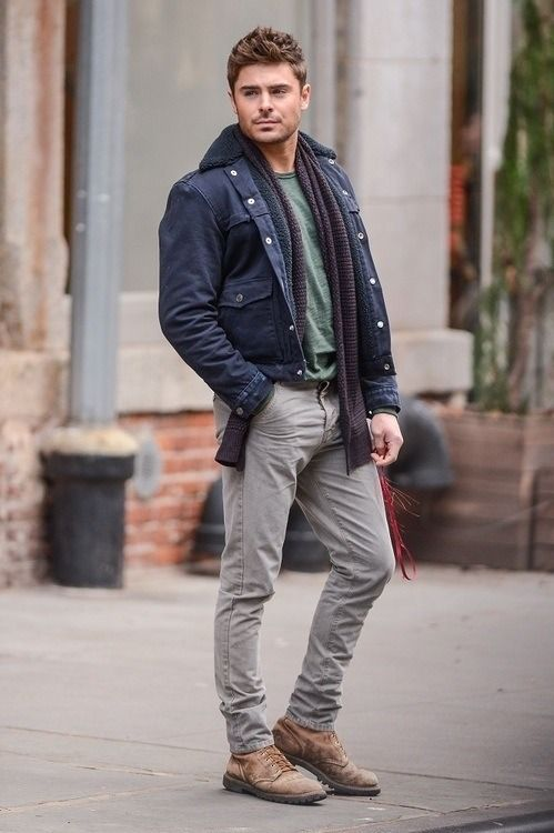 Shop Zac Efron's look for $280:  http://lookastic.com/men/looks/boots-and-jeans-and-military-jacket-and-scarf-and-crew-neck-t-shirt/1308  — Brown Leather Boots  — Grey Jeans  — Navy Military Jacket  — Violet Scarf  — Green Crew-neck T-shirt