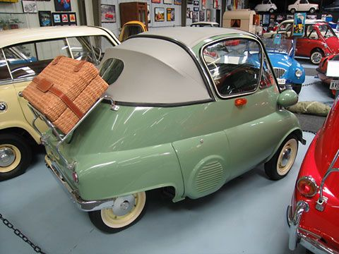 "1956 BMW Isetta 300 export cabrio. All BMW Isettas had sunroofs. SOME BMW Isettas had convertible tops  This is an example of one of perhaps 50 bubble window style cabrio cars manufactured by BMW.  Most all of these were exported out of Germany and sold in the US or South America. The ""tropical"" door vent feature was not a ""normal"" accessory for these cars but a set of them were exported to South America with this feature and that is where this car came from."